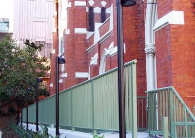 Circular wall mount poles